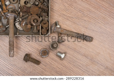 Rusty screw and nuts, corrosion bolt