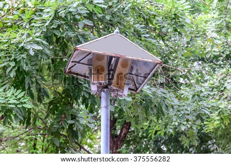 Rusty speakers with rainproof roof for announcement broadcasting.