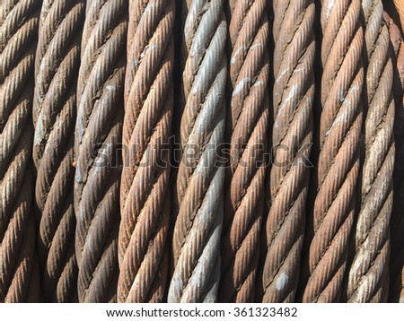 Rusty steel chain ropes. ship equipment - material background.Wire rope texture. - stock photo