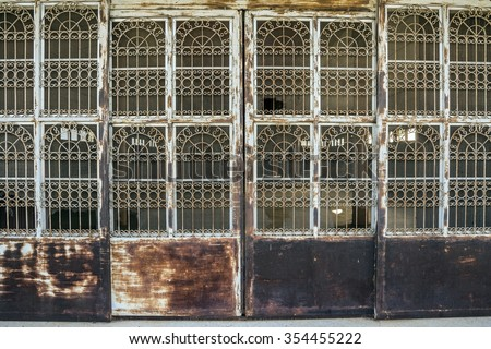 Rusty steel collapsible door texture, old fashion style shutter gate - Old red folding metal door gate - stock photo