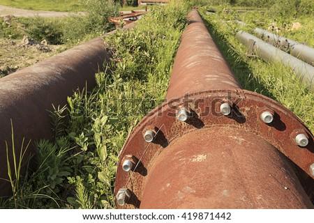 Rusty steel pipelines in grass field Rusty steel pipelines pipeline Rusty steel pipelines pipeline Rusty steel pipelines pipeline Rusty steel pipelines pipeline Rusty steel pipelines pipeline Rusty - stock photo