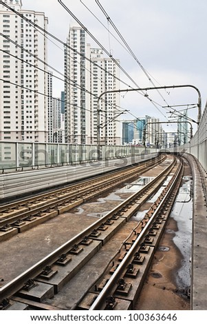 Rusty subway rails in downtown Shanghai - stock photo