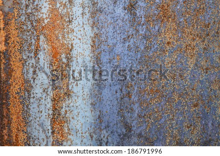 Rusty surface with vertical structure - stock photo