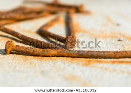 Rusty tack - stock photo