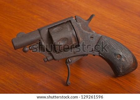 Rusty vintage French .25 revolver - stock photo