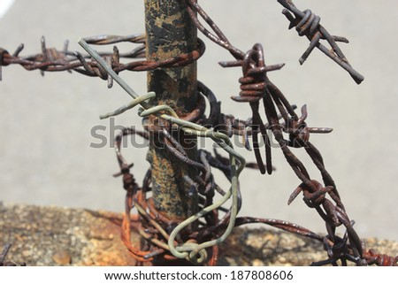 Rusty wires rapped around a pole  - stock photo