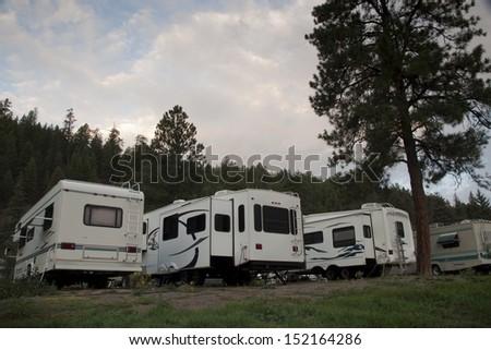 RV campsite at sunrise in Pagosa Springs, Colorado. - stock photo
