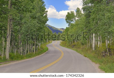 RV Trip: Windy Road Driving in the Rocky Mountains - stock photo