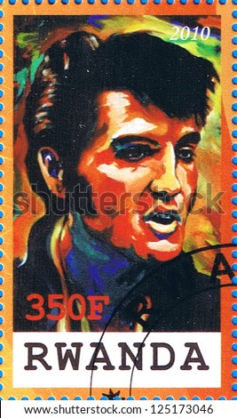 RWANDA - CIRCA 2010: A postage stamp printed in the Republic of Rwanda showing Elvis Aaron Presley, circa 2010 - stock photo