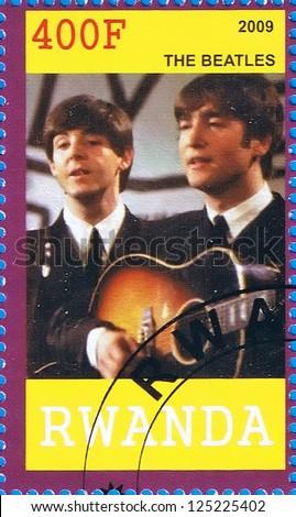 RWANDA - CIRCA 2009: A postage stamp printed in the Republic of Rwanda showing The Beatles, circa 2009 - stock photo