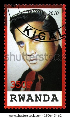 RWANDA, CIRCA 2010: A Rwandan Postage Stamp commemorating the King of Rock & Roll Elvis Presley, circa 2010. - stock photo
