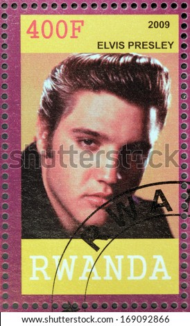 RWANDA - CIRCA 2009: A stamp printed by Republic of RWANDA shows image portrait of famous American singer Elvis Aaron Presley, circa 2009. - stock photo