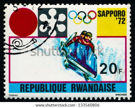 RWANDA - CIRCA 1972: A stamp printed in Rwanda shows Bobsleigh athletes at the Olympic Games in Sapporo, circa 1972