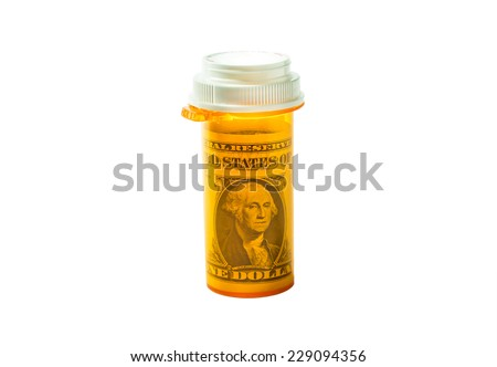 Rx bottle with a dollar bill inside isolated on a white background.Concept for Flexible Spending Account or medical expense FSA or health savings account (HSA) or a health reimbursement account (HRA). - stock photo
