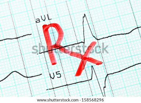 RX (prescription) inscription on cardiogram.