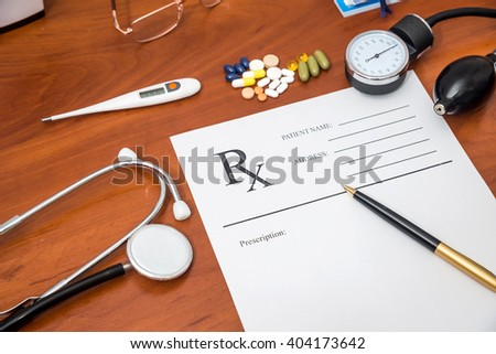 rx prescription with pills, stethoscope, thermometer and pen - stock photo