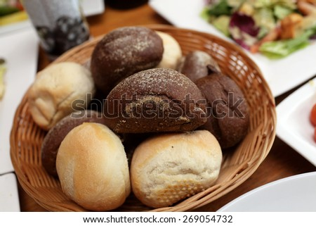 Rye and wheat bread in a basket - stock photo