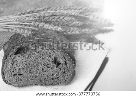 rye bread and ears on the table - stock photo