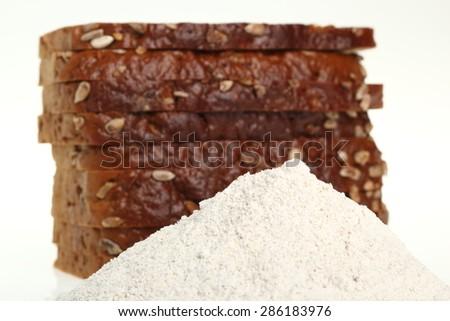 Rye bread and rye flour - stock photo