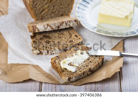 Rye bread and some butter to spread on the slices