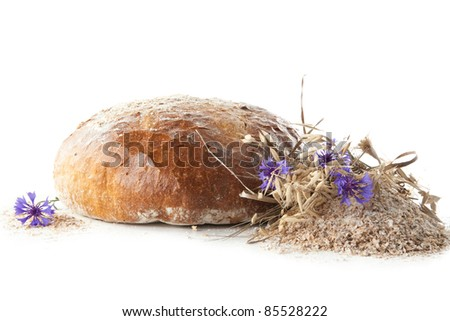 rye bread decorated with cornflower - stock photo