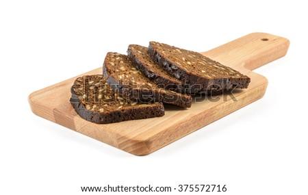 rye bread loafs on the wooden desk - stock photo