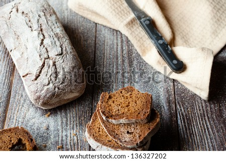 Rye bread on a wooden table, closeup