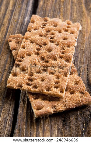 Rye Crisp Bread on wooden background - stock photo