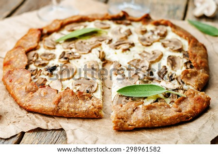 rye Galette with ricotta, onions and mushrooms. the toning. selective focus - stock photo