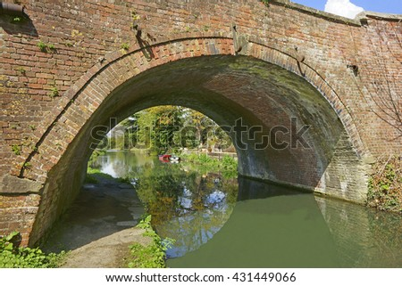 Ryford bridge in Spring on the Stroudwater, Thames and Severn Canal as it flows through the Stroud Valley at Stonehouse near Stroud, The Cotswolds, Gloucestershire, England, U K