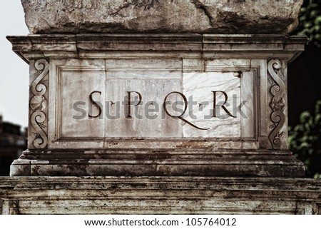 S.P.Q.R. sign on a pedestal in the Roman Capitol - stock photo