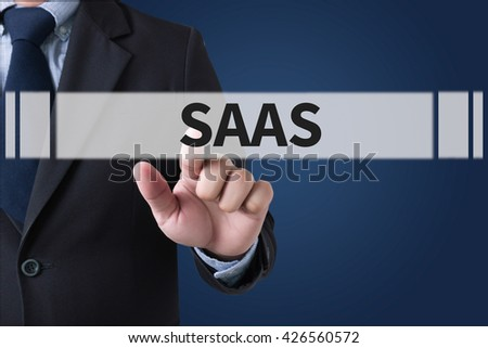 SAAS Businessman hands touching on virtual screen and blurred city background - stock photo