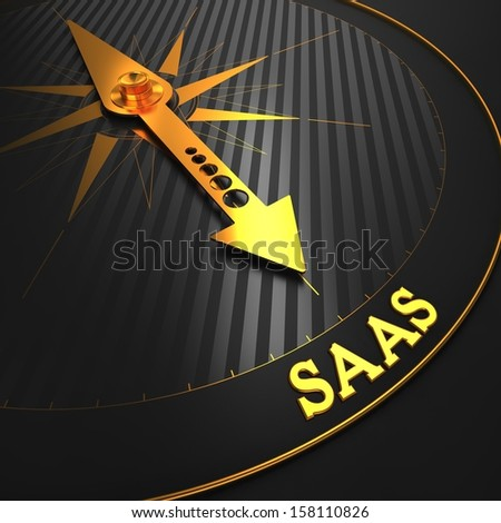 """SAAS - Information Technology Concept. Golden Compass Needle on a Black Field Pointing to the Word """"SAAS"""". 3D Render. - stock photo"""