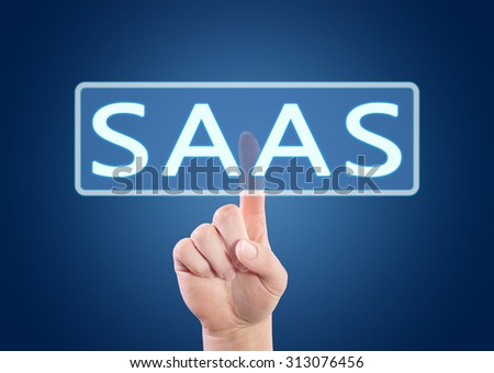 SaaS - Software as a Service - hand pressing button on interface with blue background. - stock photo