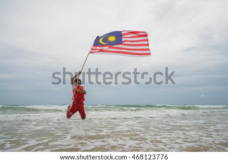 Sabah, Malaysia : 06 August 2016 : Malaysian kids jumping with waving Malaysia Flag. Independence Day celebration
