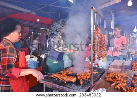 SABAH, MALAYSIA - MAY 31, 2015 : Unidentified people sells roasted chicken wings at KDCA Food Stall Market during the grand Harvest Festival on May 31, 2015 in Kota Kinabalu, Sabah Borneo, Malaysia. - stock photo