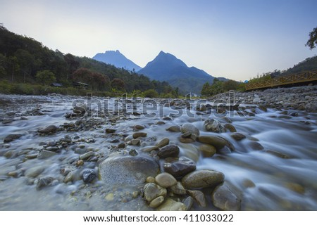 Sabah North Borneo Malaysian landscape with river and Mount Kinabalu at far background during morning - stock photo