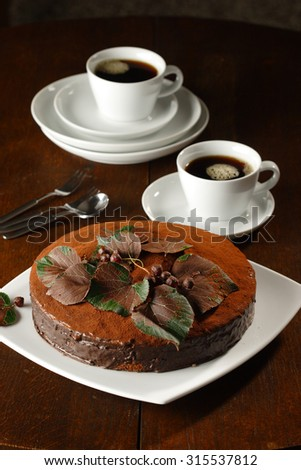 Sacher cake with coffee set - stock photo