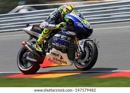 SACHSENRING - GERMANY, JULY 12: Italian Yamaha rider Valentino Rossi at 2013 Eni MotoGP of Germany at Sachsenring circuit on July 12, 2013 - stock photo