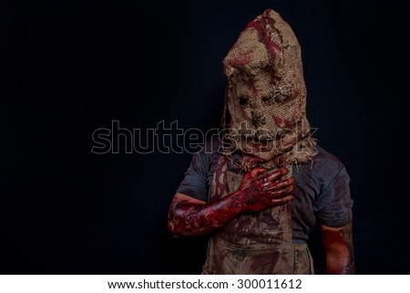 Sack ghost Fear and Halloween Theme: creepy killer in a mask on a dark background painted Tina fear. - stock photo