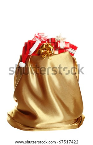 Sack of gold color filled to the brim with Christmas gifts. At one gift Santa's wearing a cap. Isolated on a white background - stock photo