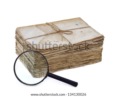 Sack of old letters with magnifier isolated - stock photo