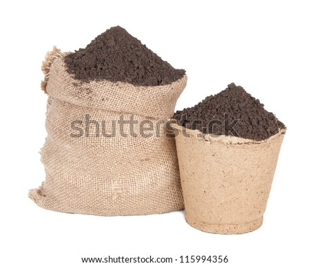Sack of soil and peat pot