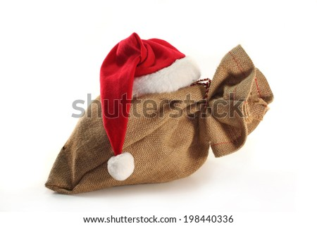 sack with christmas hat - stock photo