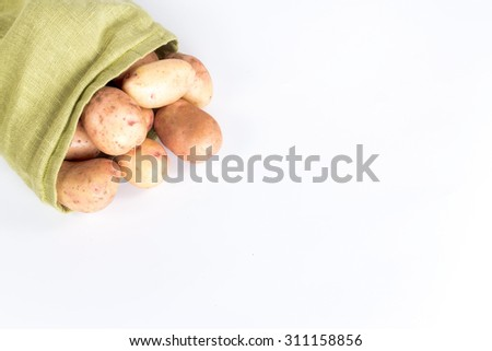 sack with crumbled potato tubers isolated on white background