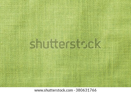 Sackcloth woven texture pattern background light green earth color tone: Eco friendly raw organic flax sack cloth fabric textile backdrop: Bag rope thread detailed textured burlap canvas - stock photo