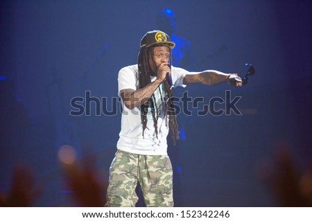 SACRAMENTO, CA - AUGUST 28: Rapper Dwayne Michael Carter, Jr. aka Lil Wayne performs in concert as part of America's Most Wanted Tour at Sleep Train Arena on August 28, 2013 in Sacramento, California. - stock photo