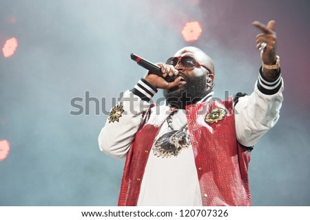 SACRAMENTO, CA - December 1: Rick Ross performs in his MMG Tour featuring Machine Gun Kelly, Meek Mill, and Wale Folarin at Sleep Train Arena in Sacramento, California on December 1, 2012. - stock photo