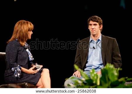 "SACRAMENTO, CA - February 24, 2009: Tamara Lowe interviews Michael Phelps at a ""Get Motivated"" Seminar at the Arco Arena in Sacramento, California. - stock photo"