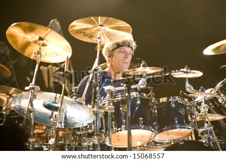 Sacramento, CA - July 17,2008: Drummer Stewart Copeland performs on-stage at the Sleep Train Amphitheater in Marysville, CA with The Police in their North American Reunion Tour - stock photo